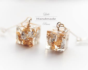 Silver and gold hanging earrings | copper filled silver wire wrapped hammered with silver and gold foil in resin cast