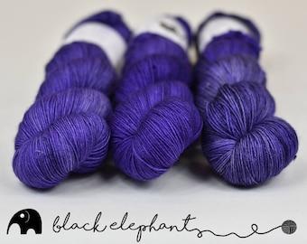 Starlight hand dyed sock yarn  superwash merino contemporary 4 ply yarn speckled yarn purple black 100g