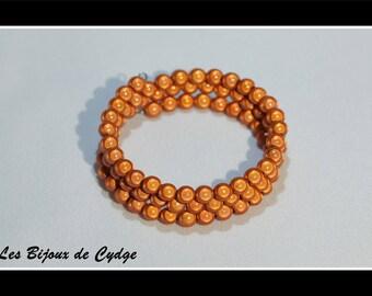 Orange magic beads on 3 rows of 55mm memory bracelet