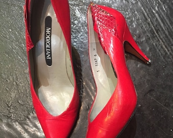 Vibrant sultry red Modigliani pumps with faux snake detail