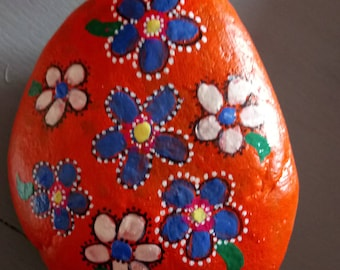 Stone has orange flower