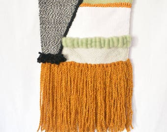 Modern woven wall hanging in wool