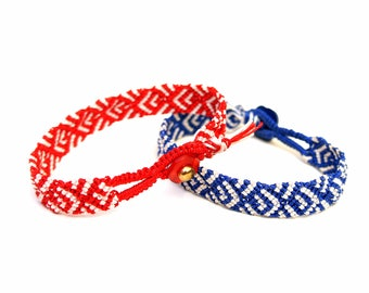 Peer's hand knotted bracelet: blue or red with white c lon bead cord and a button clasp