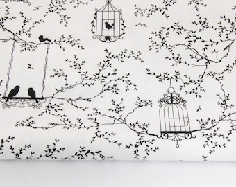 100% cotton fabric coupon printed light cages and black birds on a white 160 x 50 cm.