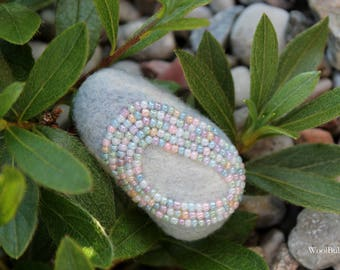 Needle felted brooch with decoration