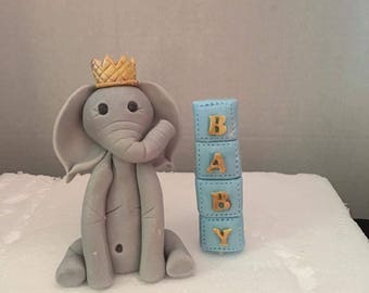 Fondant elephant with crown and blocks cake topper