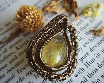 Super rare, Quartz with Limonite inclusions. Wire Wrapped Antique Brass Pendant on matching brass chain