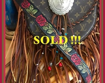 Louis Vuitton cross body upcycled with western roses belt/strap, fringe, concho and beads.