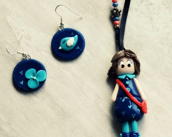 Set in a blue dress doll and its matching earrings