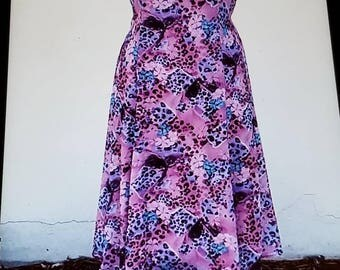 Pink and purple long pointed tail Beautifully fit and flair long or short sleeves Dress