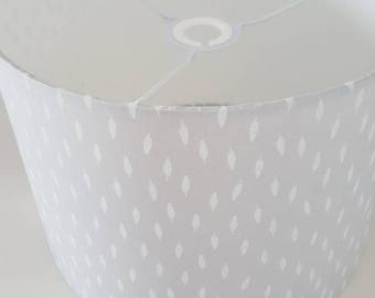 Handmade drum lampshade. Grey with white feather material.