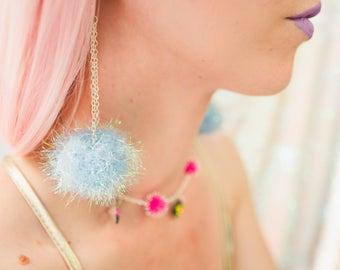 Earrings: Pom pom earrings