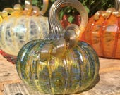 Small iridescent olive hand blown glass pumpkin with gold stem