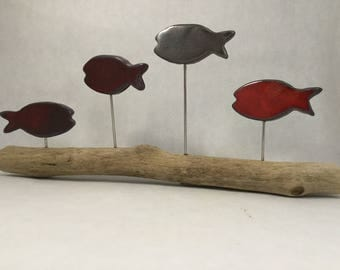 4 fish glazed in red and metallic grey on Driftwood