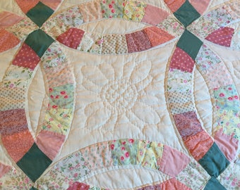 Vintage quilt, pink and white double wedding ring pattern
