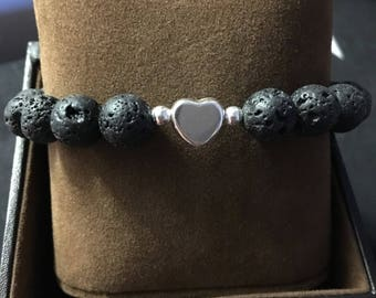 Black lava stone with sterling silver heart