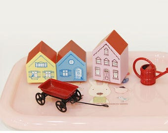 wooden and rubber stamps in the shape of small houses