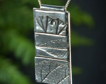 Handmade silver pendant - textured with real leaves