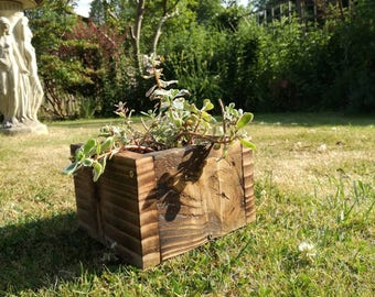 A Lovely rustic wooden planter