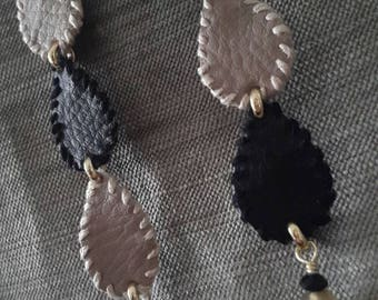 Black and beige leather earrings