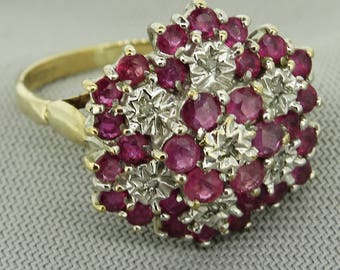 A 9 Ct Ruby & Diamond Cluster Gold Ring
