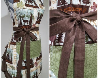 Adult apron. Woman's apron. Log cabin apron with Moose, leaves and Bear in collage. Different greens and browns on pocket, ties and frills.
