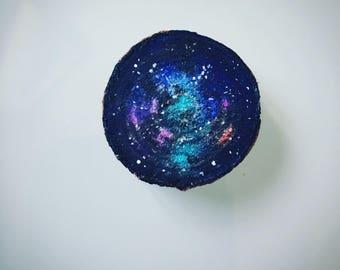Galaxy painting on log