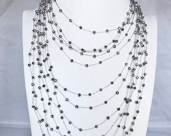 Multi row necklace with silver crystals