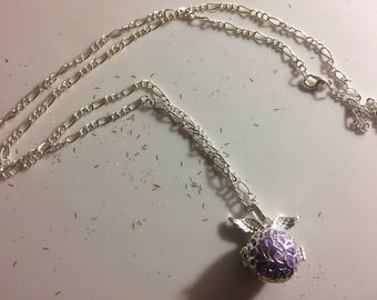 """Purple """"bola"""" with angel wing and bead necklace."""