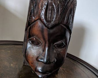 Carved wooden African female head