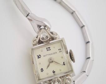 A vintage Wittnauer 14k white gold ladies wrist watch with 2 round diamonds