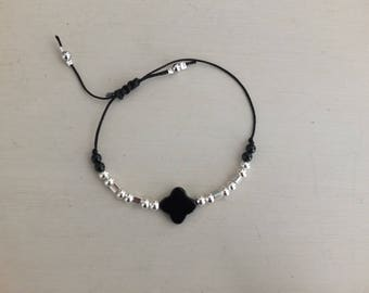 Bracelet black and silver length adjustable.