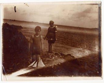 Vintage photo woman sepia seaside and boy