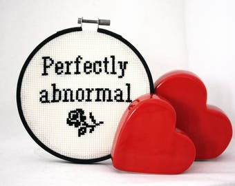 Perfectly Abnormal- completed cross stitch quote. Finished and framed in embroidery hoop. Contemporary wall hanging sign decoration.