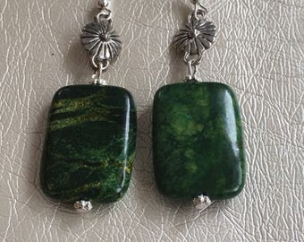 Green Earrings hanging on a silver dangle. Green Dangle earrings.  Hanging on silver ear wire.