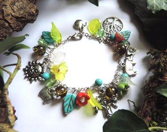 """Country walk"" Bracelet: Sun, scarecrow, pig, RAM, Apple, tree of life, lucites green and red flowers, pearls"