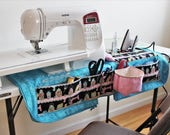 Quilted sewing machine mat organizer and tote bag pattern: travel sewing station with ironing pad, pincushion, thread  catcher, and pockets