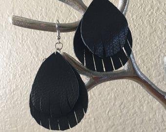 Black leather with fringed edges