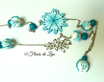 Turquoise and white polymer clay necklace, flower and assorted beads.