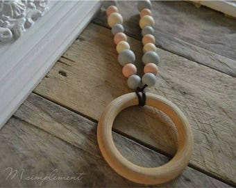 Teething necklace. [Charming wood].