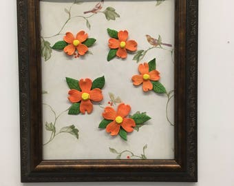 Frame is recycled with orange flowers