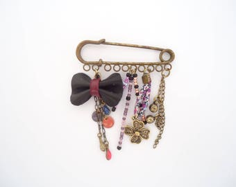 Brooch beads is leather bow