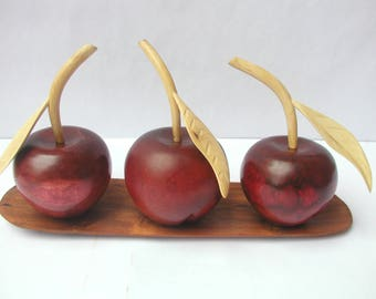 Decorative wooden tray with apples.