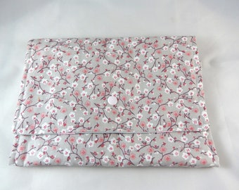 Pouch tucks barrettes and headbands in pink and gray