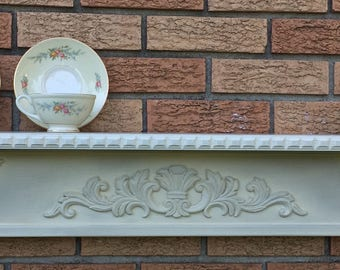 """Beautiful, appliqued fireplace mantel, featuring dentil molding and gorgeous corbels  in a """"ghost shadow"""" finish accentuating it's beauty."""