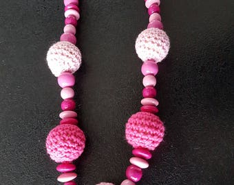 teething necklace in fuchsia and pink wood