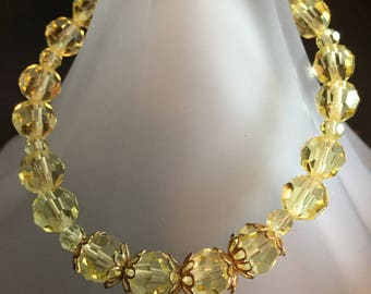 From the Fee-Nest Bracelet Collection Yellow Czech Crystal Bead Bracelet
