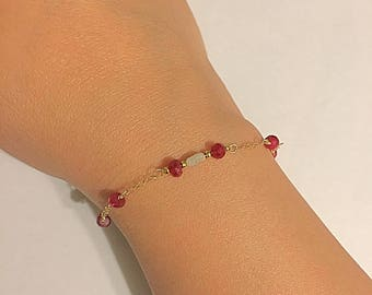 Faceted rubies and rough white diamond bracelet