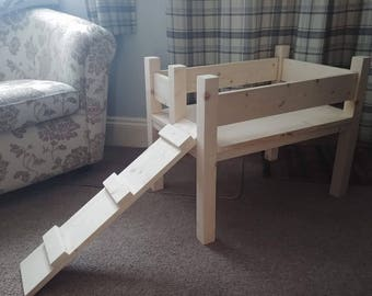 handmade single tier raised dog bed with ramp for small breed of dog
