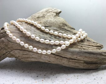 Very long White  fresh-water pearl necklace